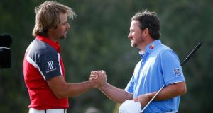 Victor Dubuisson  and Graeme McDowell  shake hands after the Frenchman's  quarter-final victory at the Accenture World Match Play Championship  at Dove Mountain in Marana, Arizona. Photograph: Sam Greenwood/Getty Images