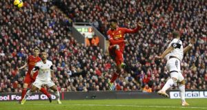 Daniel Sturridge scores his second and Liverpool's third against Swansea  at Anfield. Photograph: Peter Byrne/PA Wire.