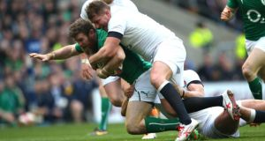 Ireland's Gordon D'Arcy is tackled by England's Dylan Hartley. Photograph: Billy Stickland/Inpho