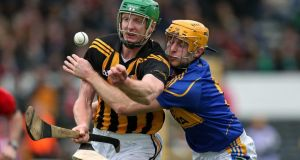 Kilkenny's Henry Shefflin battles with  Shane McGrath of Tipperary during the league clash at Nowlan Park. Photo: Ryan Byrne/Inpho