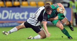 Zebre's Dario Chistolini tackles Jason Harris-Wright of Connacht during the clash at the  Stadio XXV Aprile. Photo: Francesca Soli/Inpho