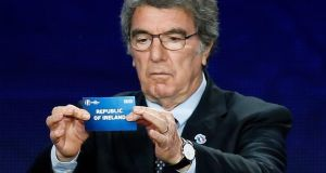 "Former Italy goalkeeper Dino Zoff  holds the slip showing ""Republic of Ireland"" during the  qualifying draw in Nice yesterday."