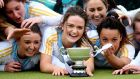 UCD captain Sarah Greene and team-mates celebrate with thw Irish Senior Cup.  Photograph: James Crombie/Inpho
