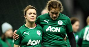"Ireland's Lynne Cantwell and Fiona Coghlan look dejected after defaet to England. ""We're matching them woman for woman,"" George Hook said at half-time. Photograph: James Crombie/Inpho"