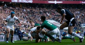 England's Jonny May is denied a try scoring opportunity by Ireland's Andrew Trimble and Conor Murray during the Six Nations match at Twickenham.
