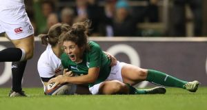 Ireland's Larissa Muldoon celebrates scoring her try against England in the  Women's Six Nations match at Twickenham on Saturday. Photograph: James Crombie/Inpho