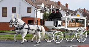 A horse-drawn carriage brings the coffin carrying the body of Sonia Blount from  the Holy Rosary Church, Ballycragh, Tallaght. Photograph:  Colin Keegan/Collins Dublin