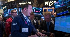 Traders on the floor of the New York Stock Exchange have an edge; but it's very difficult for individual investors to make predictions on GDP that are not already embedded into stock prices. Photograph: Reuters