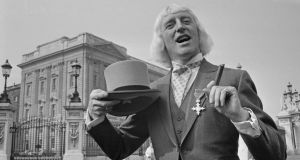 Jimmy Savile showing off his OBE in 1972. Only a tiny number of his victims immediately raised the alarm with hospital staff or family, according to a new NSPCC report. Photograph: Leslie Lee/Daily Express/Hulton Archive/Getty Images.