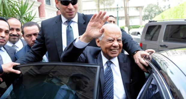 Outgoing Egyptian prime minister Hazem el-Beblawi waves as he leaves government headquarters in Cairo on Monday after announcing the government's resignation. Photograph. EPA/STR