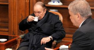 Algeria's president Abdelaziz Bouteflika drinking tea with prime minister Abdelmalek Sellal when he was being treated for a stroke in a Paris hospital on June 11th, 2013. Photograph: AFP/Getty Image
