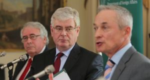 Junior trade minister Joe Costello, Tánaiste Eamon Gilmore and Minister for  Jobs, Enterprise and Innovation Richard Bruton at the launch of the Review of the Government Trade, Tourism and Investment Strategy, at Iveagh House in Dublin yesterday. Photograph: Niall Carson/PA Wire