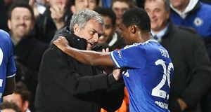 Chelsea manager Jose Mourinho and striker Samuel Eto'o share a laugh on the sideline.  Photograph: Adam Davy/PA