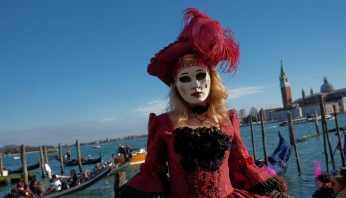Sadness amid beauty... a masked reveller poses in Saint Mark's Square during the Venetian Carnival in Venice, currently running. Photograph: Manuel Silvestri/Reuters
