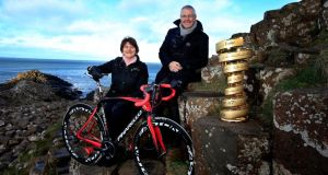 Stephen Roche, pictured with Northern Ireland investment minister Arlene Foster, has been inducted into the Giro d'Italia Hall of Fame.