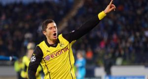 Robert Lewandowski celebrates  Dortmund's fourth goal against Zenit. Photograph: Alex Grimm/Bongarts/Getty Images