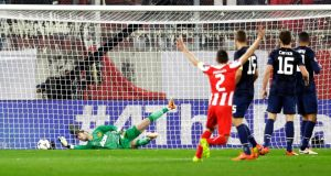 Alejandro Dominguez's flick beats the  Manchester United goalkeeper David de Gea for Olympiakos' first goal. Photograph: Thanassis Stavrakis/AP