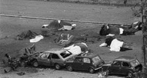 Dead horses lie covered adjacent to wrecked cars at the scene of an IRA car bombing when the Household Cavalry was passing, in Hyde Park, London, in 1982. Photograph: PA