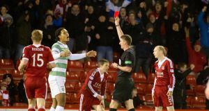 Celtic's Virgil van Dijk is sent off during the  match at Pittodrie. Photograph: Kenny Smith/PA Wire.