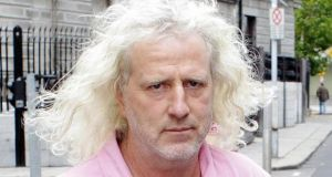 "Independent TD Mick Wallace shouted at Alan Shatter in the Dáil today:  ""Minister, you look up at us and you say how dare those people with the long air and raggy jeans have the audacity to challenge you?"""