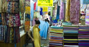 Bogyoke Aung San Market, a sprawling enclosure built in 1926, is the place to buy the sarong-like longyi