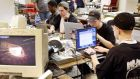 A group of computer hackers work on laptop computers. Photograph: REUTERS/Jeff Christensen