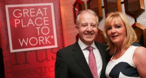 John Ryan, CEO of Great Place to Work Ireland, with Louise Phelan of PayPal, who was recognised as Ireland's Most Trusted Leader 2014.
