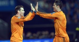 Gareth Bale celebrates his first goal against Schalke with Cristiano Ronaldo. Photograph: Federico Gambarin/EPA