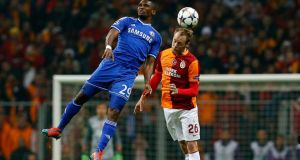 Semih Kaya (R) of Galatasaray vies for the ball with Samuel Eto'o (L)   during the UEFA Champions League round of 16 first leg match. Kerim Okten.