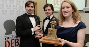 Irish Times debate winners Kate Brady (TCD Hist) with Liam Brophy and John Engle (right) from the TCD Bram Stoker club after this evenings 2013 Irish Times Debate Final held in Queens Universtiy's Riddel Hall. Photograph: Charles McQuillan/Pacemaker.