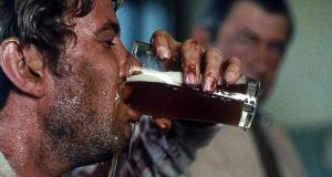 Gary Bond attempts to drink like a real man in Ted Kotcheff's Wake in Fright