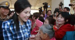 Supporters greet Thai prime minister Yingluck Shinawatra in the northern town of Chiang Mai today. Photograph: Reuters