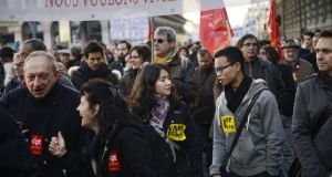 Protesters march on the headquarters of the employers' federation Medef in Paris yesterday. Photograph: Martin Bureau/AFP/Getty Images
