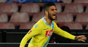 Lorenzo Insigne of Napoli celebrates after scoring against Swansea  at Stadio San Paolo. Photograph:  Giuseppe Bellini/Getty Images
