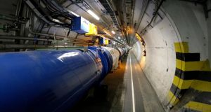 FILE - The LHC (large hadron collider) in its tunnel at CERN (European particle physics laboratory) near Geneva, Switzerland