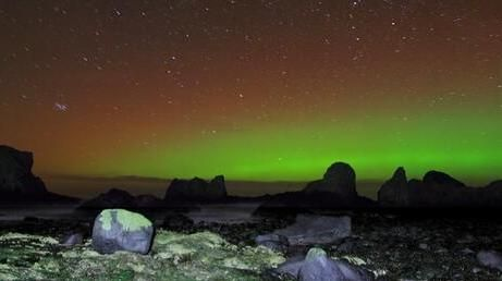 The Aurora Borealis or Northern Lights in full glory at Elephant Rock, Ballintoy, Co Antrim. Photograph: Stephen Wallace/Hibernia Landscapes/@Hiberniaphoto