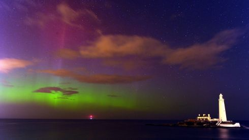 The breathtaking beauty of the Aurora Borealis, or the northern lights as they are commonly known, at St Mary's Lighthouse and Visitor Centre, Whitley Bay, North Tyneside. Photograph: Owen Humphreys/PA Wire
