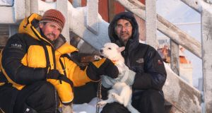 Daylight saving: Charlie Bird with Jopee Kiguktak and his dog in Grise Fiord