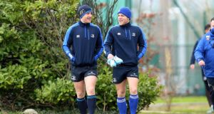 Luke Fitzgerald and Ian Madigan arrive for Leinster training. Photograph:  Donall Farmer/Inpho