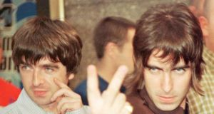Noel and Liam Gallagher in 1996: providing the songtrack to the bacchanalia. Photograph: Reuters
