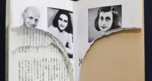 Ripped pages of Anne Frank's 'Diary of a Young Girl'  at a library in Tokyo.  Pages of the book have been methodically ripped out of dozens of libaries in the Japanese capital. Photograph: Kyodo/Reuters