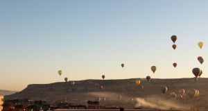 Hot air balloons rise over the Cappadocian town of Göreme, where 23 hot air balloon companies compete for business. Turkey's tourism industry could be hurt, however, by images of ongoing protests and an increasingly belligerent prime minister. Photograph: Stephen Starr