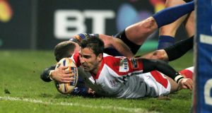 Ulster's Ruan Pienaar goes over for the opening try. Photograph: Darren Kidd/Presseye/Inpho