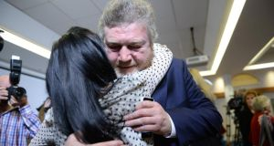 MInister for Health Dr James Reilly is hugged by Natasha Molyneaux, mother of Nathan, following the Department of Health press conference on the Midland Regional Hospital Portlaoise yesterday. Photograph: Cyril Byrne