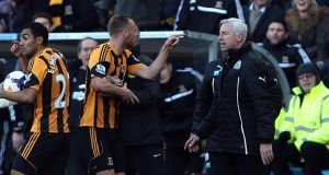 Newcastle United's manager Alan Pardew and Hull City's David Meyler  confront each other during the match at the KC Stadium.  Photograph: Lynne Cameron/PA Wire.