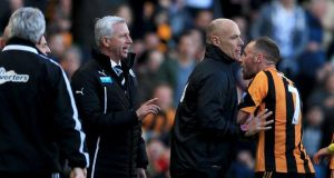 Fourth official Howard Webb restrains David Meyler after a clash with Alan Pardew. Photograph: Matthew Lewis/Getty Images