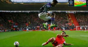 Liverpool's Daniel Sturridge jumps over a tackle from Calum Chambers during the match at St Mary's Stadium. Photograph: Andrew Winning/Reuters
