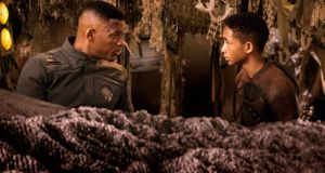 Stranded on Planet Nepotism:  Will Smith and his son Jaden appear a scene from After Earth. Photogaph: Sony, Columbia Pictures