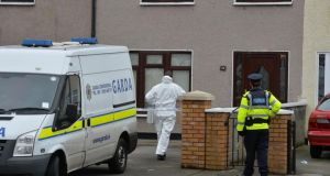 Gardai outside the house on Greensfort Crescent in Clondalkin where John Gilligan was shot while attending a family gathering last night. Photograph: Alan Betson/The Irish Times