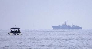 An unidentified military ship - believed to be Russian - is seen off the coast of Sevastopol, Crimea, Ukraine. Photograph: EPA